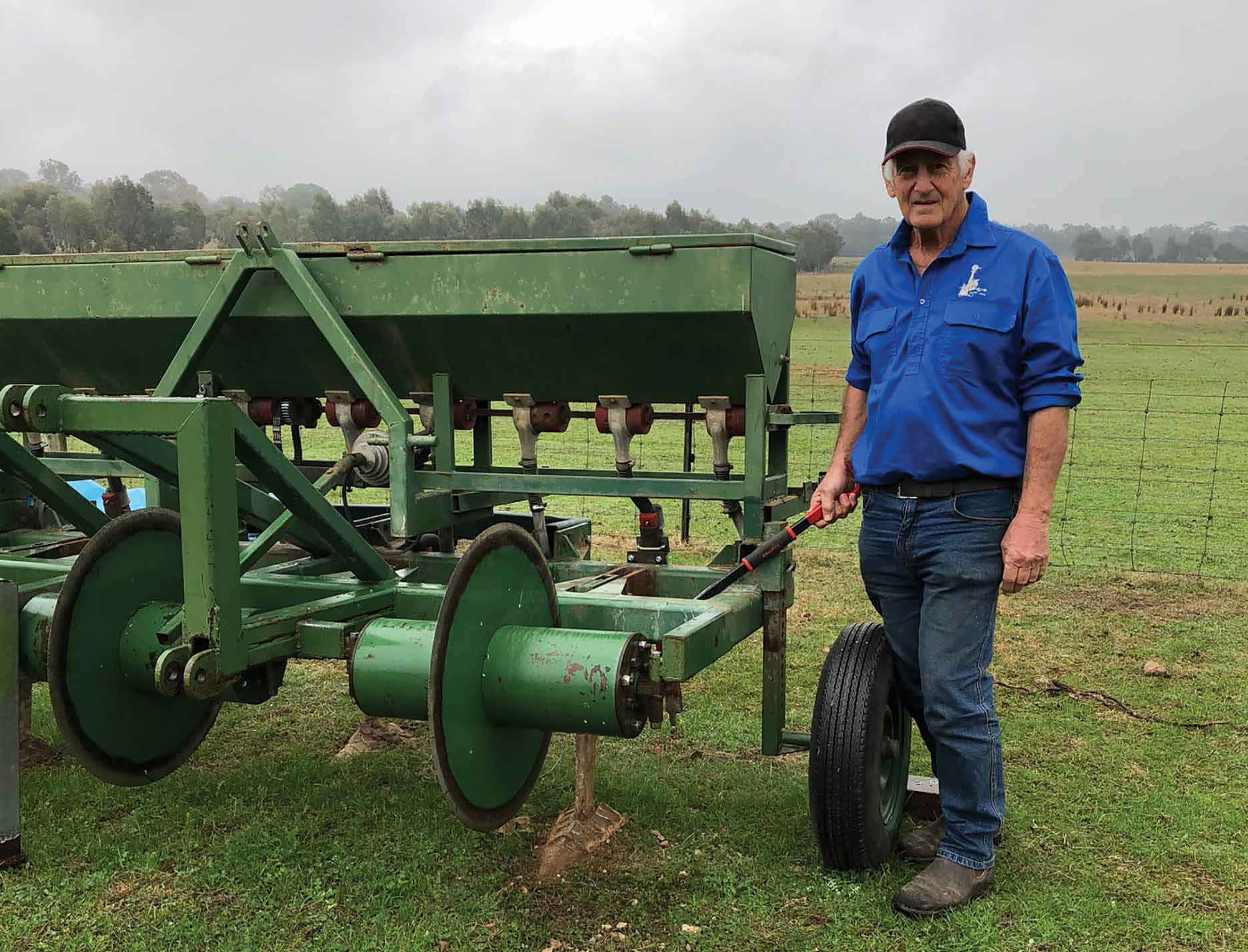 Ken Heywood from Warrenbayne, near Violet Town, demonstrating the soil aeration slipper underneath the aeration plough.