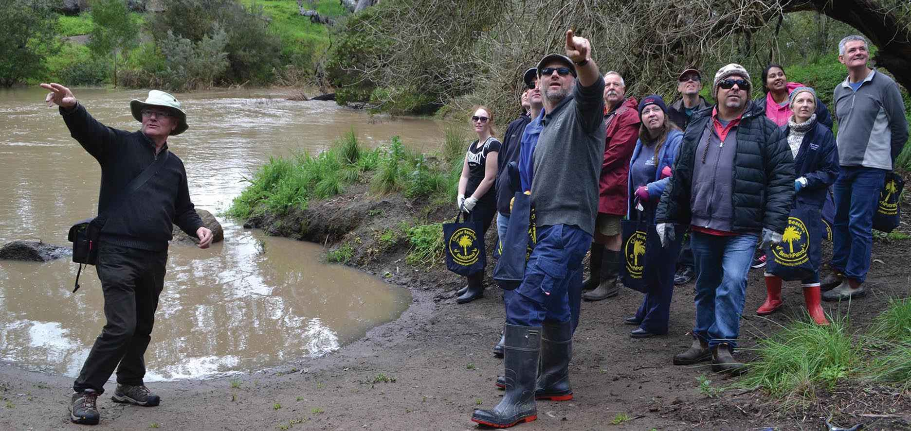 Riverkeeper John Forrester (at left) leads a group of staff from Good News Lutheran College on a walk at Cobbledicks Ford Reserve, Mount Cottrell, in the City of Wyndham.