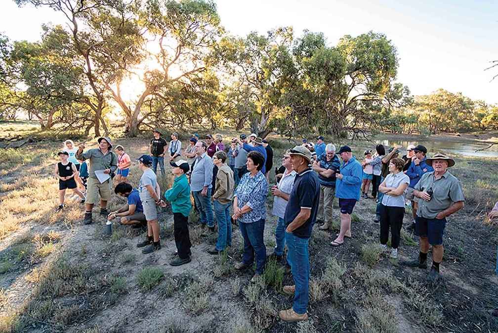 Wildlife ecologist Damien Cook leads the community through Uttiwillock wetland on a native flora and fauna walk.