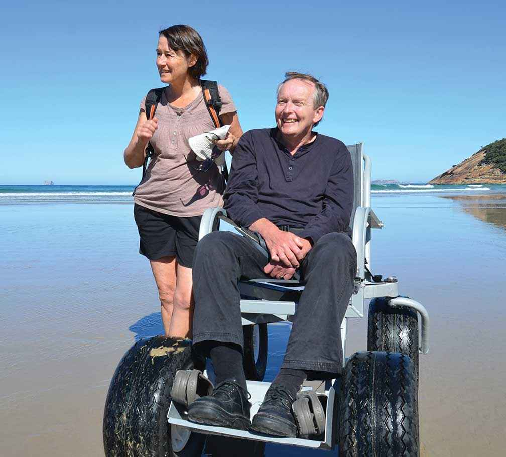 Ros Hart and David Stratton enjoy using a Parks Victoria beach wheelchair at Wilsons Promontory National Park.