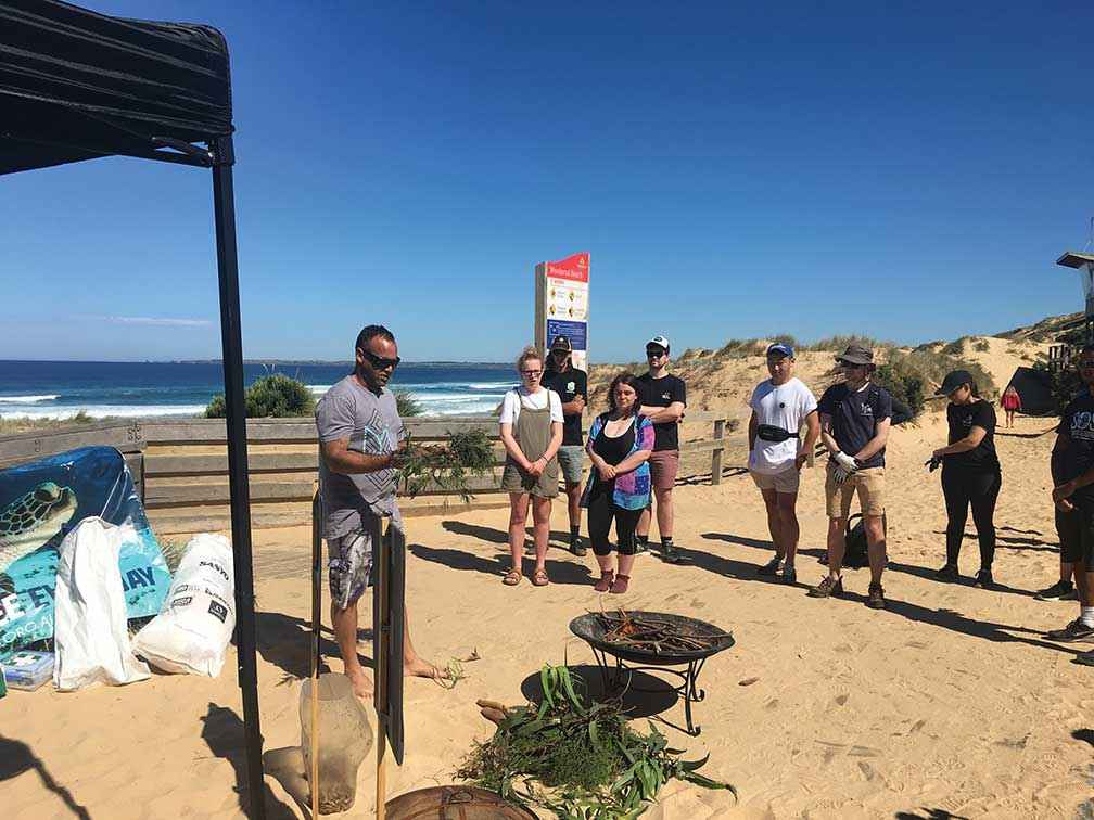 Boonwurrung man Steve Ulula Parker conducts a Welcome to Country before a clean-up at Woolamai Beach.