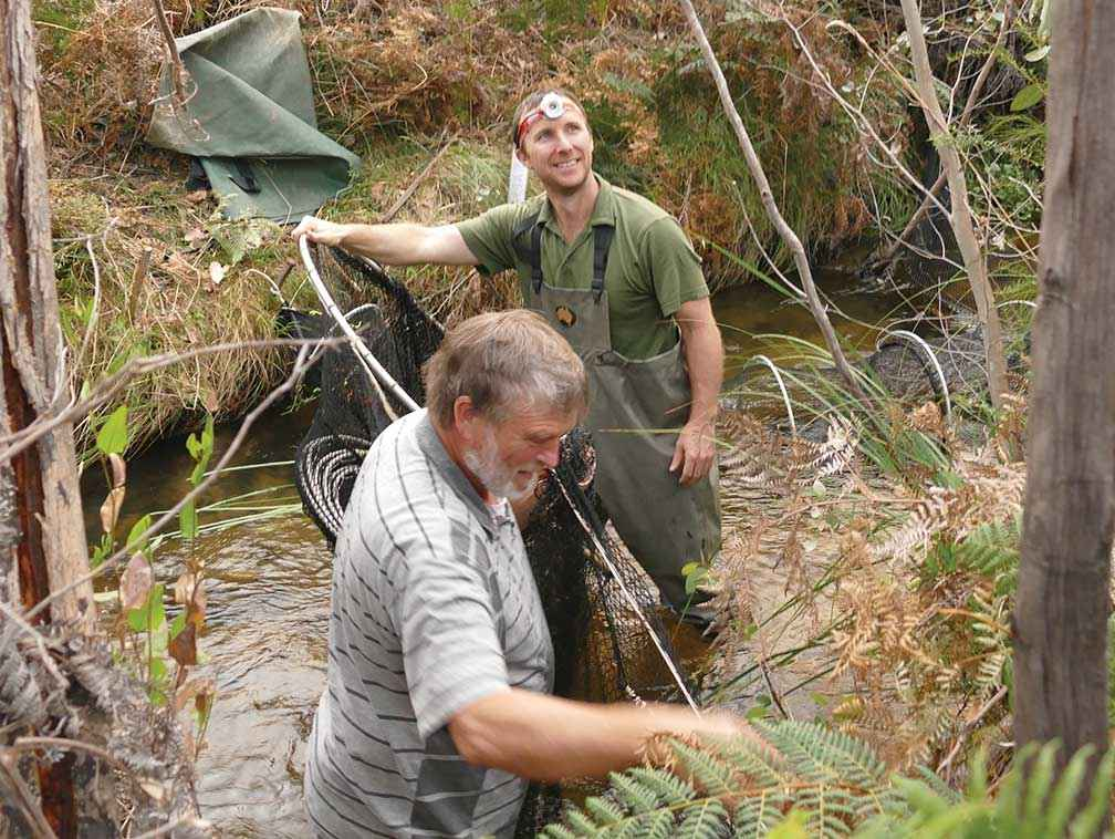 John Pye (left) assists ecologist Josh Griffiths with platypus monitoring in McKenzie Creek in 2018.