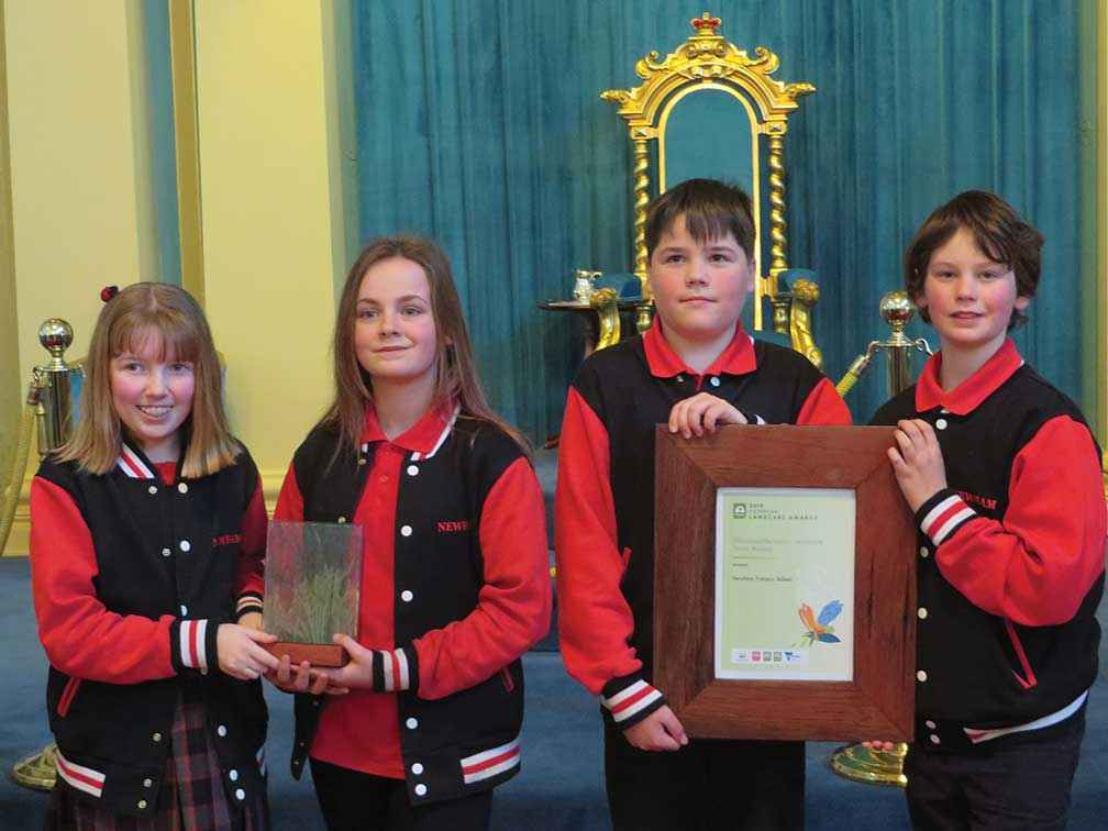 From left, Astrid Le Noury, Abbey Smith, Luke Robertson & Thorsten Perch-Neilsen from Newham Primary School with the Woolworths Junior Landcare Team Award.