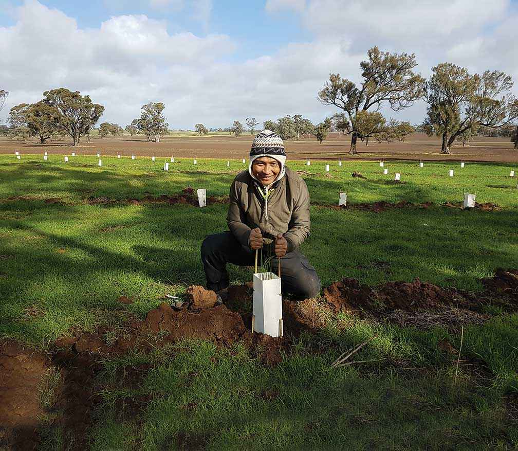 Kaw Doh Htoo from Nhill getting his hands dirty at a Project Hindmarsh planting weekend at Dinyarrak in 2018.