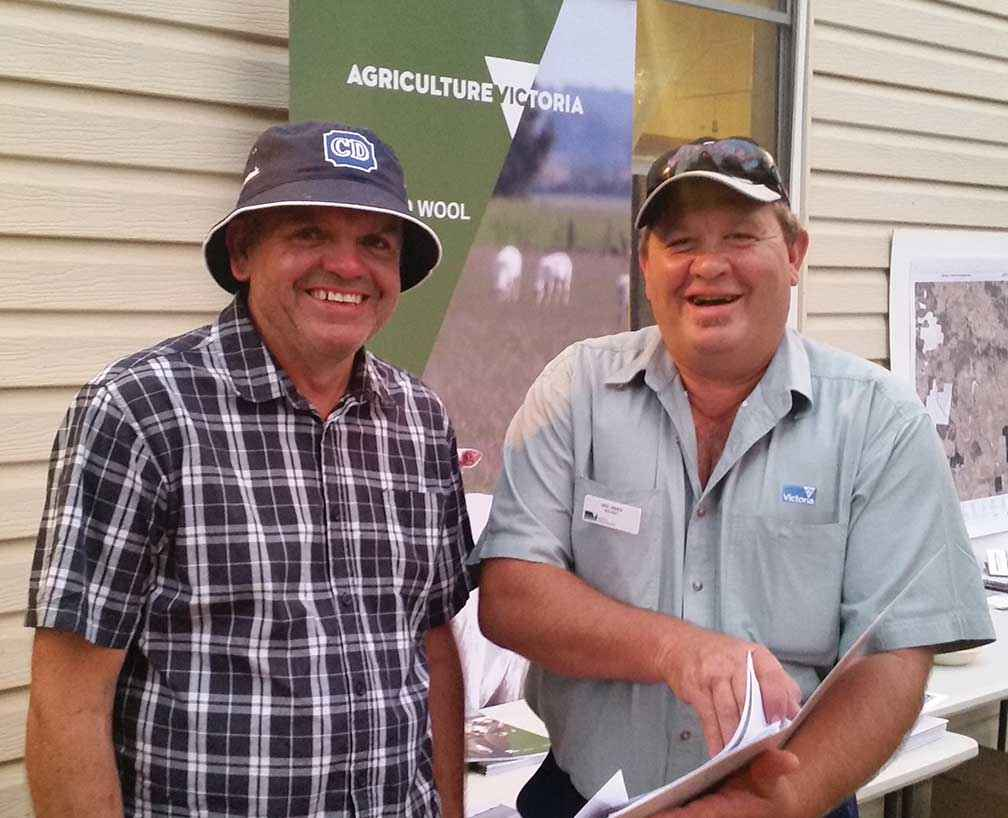 From left, landholder David Wells discusses fire recovery with Neil James from Agriculture Victoria at a community get together at Scotsburn Hall organised by the Upper Williamson's Creek Landcare Group on Christmas eve 2015.