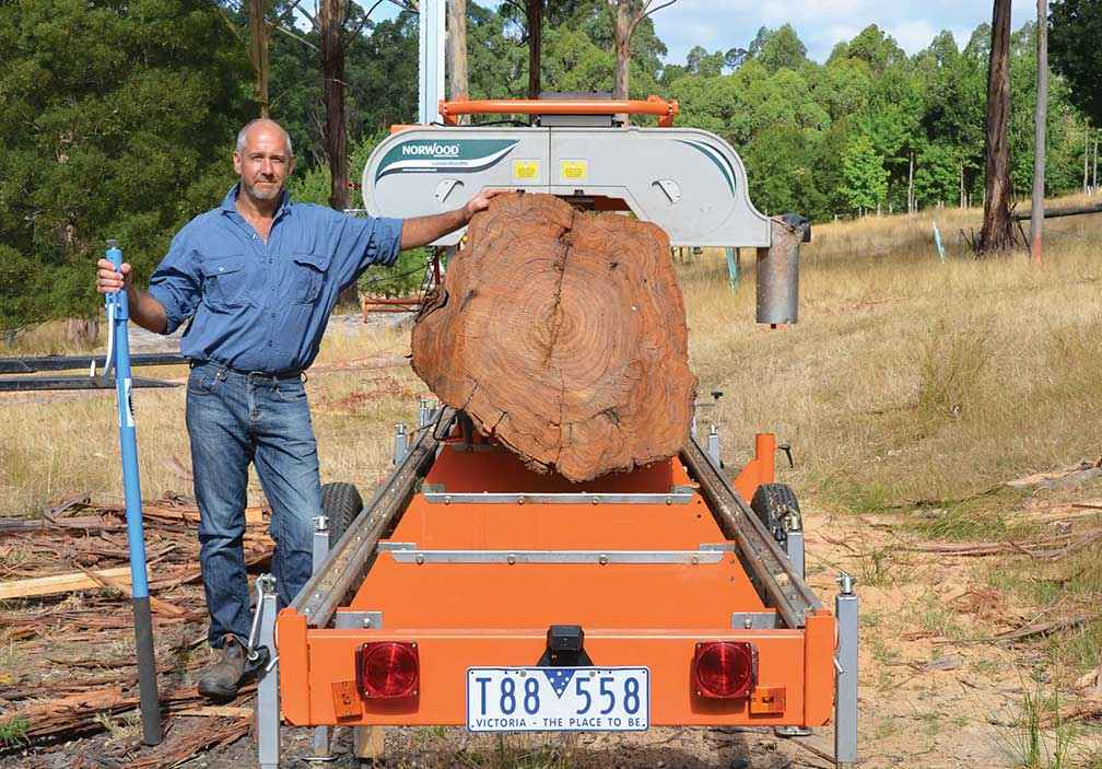 Rowan Reid with a 25-year-old eucalypt log on the bandsaw.