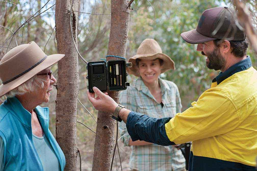 UCLN's Threatened Species Officer Brad Blake shows Campaspe Valley Landcare Group President Jan Elder and volunteer Jessica Rosien how to set up a remote sensing camera.