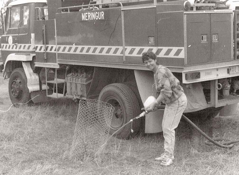 Long-term member of the Millewa-Carwarp Landcare Group Lyn Harmer watering trees in the mid 1990s.