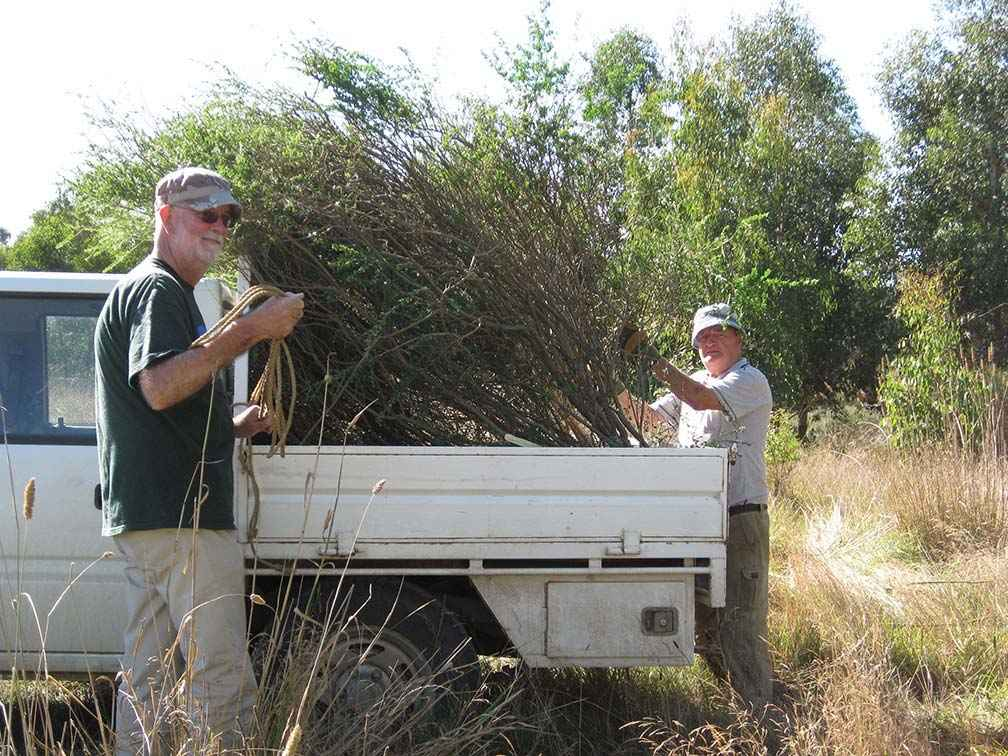 Deep Creek Landcare Group Treasurer Steven Hendy (left) and then President John Anderson during a weed and rubbish removal working bee at Sheehans Crossing in 2010.