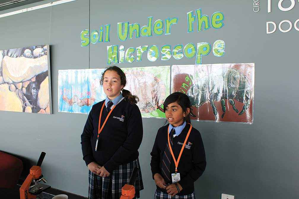 Olivia Margeta (left) and Radhe Parasram from Carranballac College presenting their science workshop on measuring pH in the soil at a Kids Teaching Kids Conference in Western Australia.