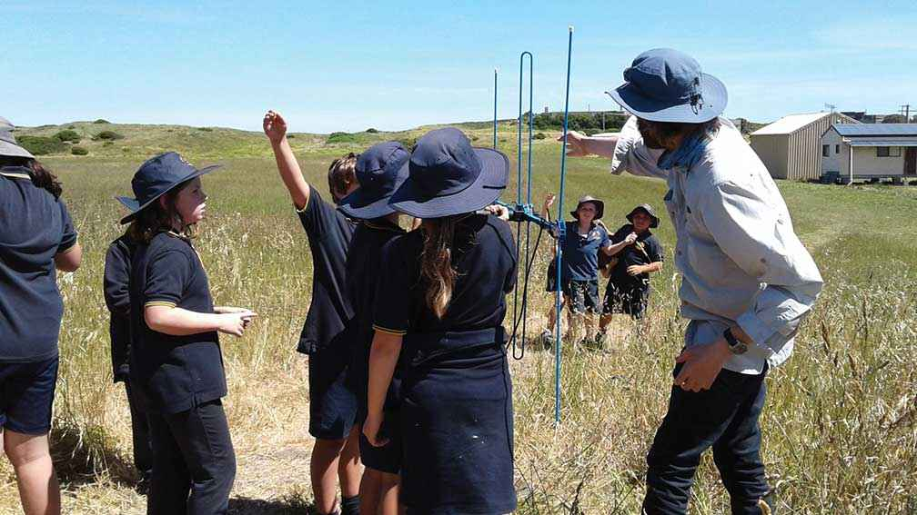 Volunteer Richard Chamberlain teaching students from Port Fairy Consolidated School how to radio-track snipe.