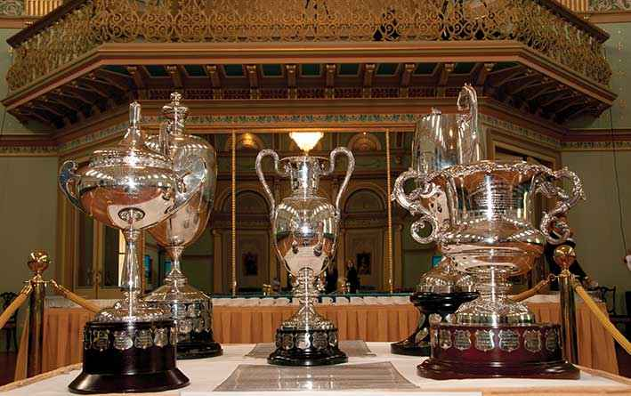 The historic Hanslow Cups that were presented to leading Victorian farmers for their efforts in soil conservation from 1940 were on display in the ballroom at Government House.