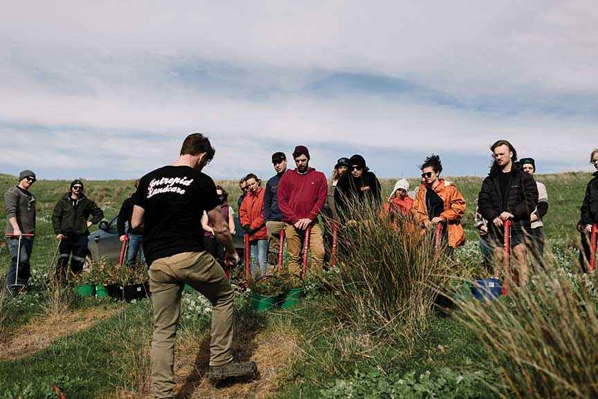 Young volunteers preparing to revegetate steep country at a plant and dance event at Cape Woolamai where 3000 native trees were established.